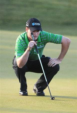LAS VEGAS- OCTOBER 16:  Zach Johnson lines up a birdie putt on the 12th hole during the first round of the Justin Timberlake Shriners Hospitals for Children Open held at the TPC Summerlin on October 16, 2008 in Las Vegas, Nevada. (Photo by Marc Feldman/Getty Images)
