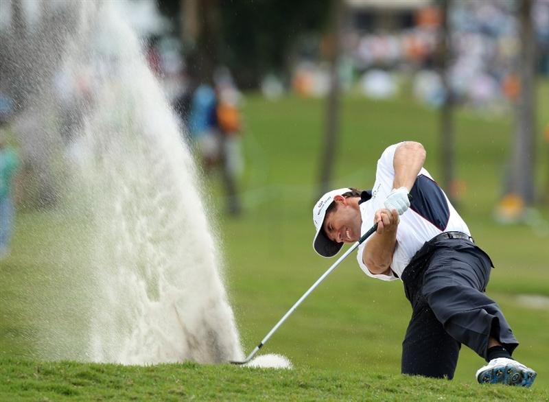 DORAL, FL - MARCH 13:  Padraig Harrington of Ireland plays his thrid shot from a 'plugged' lie in a greenside bunker at the 1st hole during the second round of the World Golf Championships-CA Championship at the Doral Golf Resort & Spa on March 13, 2009 in Miami, Florida  (Photo by David Cannon/Getty Images)