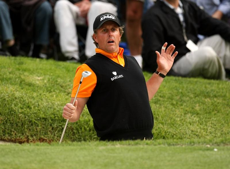 PACIFIC PALISADES, CA - FEBRUARY 21:  Phil Mickelson reacts after hitting a bunker shot close to the hole on the 17th hole during the third round of the Northern Trust Open on February 21, 2009 at Riviera Country Club in Pacific Palisades, California.  (Photo by Stephen Dunn/Getty Images)