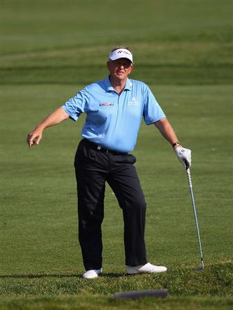 MALLORCA, SPAIN - MAY 12:  Colin Montgomerie of Scotland reacts after a shot during day one of the Iberdrola Open at Pula Golf Club on May 12, 2011 in Mallorca, Spain.  (Photo by Julian Finney/Getty Images)