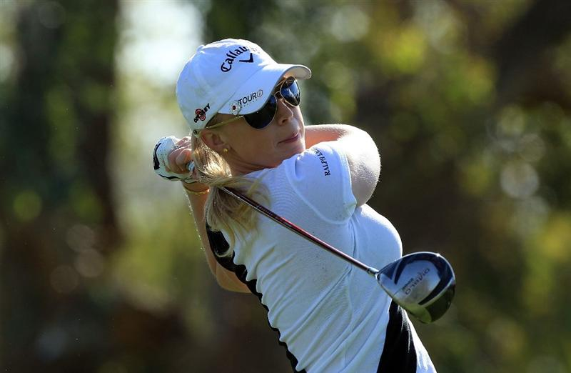 RANCHO MIRAGE, CA - APRIL 04:  Morgan Pressel of the USA plays her tee shot on the third hole during the final round of the 2010 Kraft Nabisco Championship, on the Dinah Shore Course at The Mission Hills Country Club, on April 4, 2010 in Rancho Mirage, California.  (Photo by David Cannon/Getty Images)