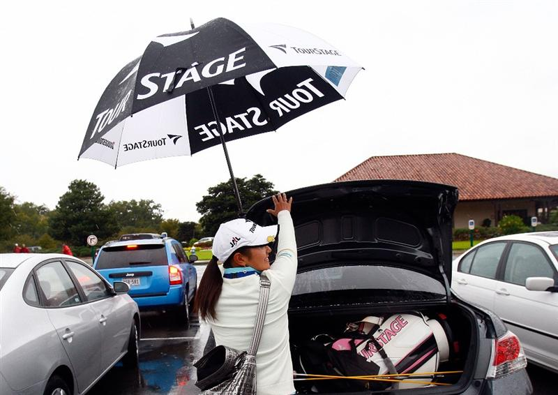 RICHMOND, TX - NOVEMBER 20:  Ai Miyazato of Japan loads her golf clubs into her car after play was suspended during the second round of the LPGA Tour Championship presented by Rolex at the Houstonian Golf and Country Club on November 20, 2009 in Richmond, Texas.  (Photo by Scott Halleran/Getty Images)
