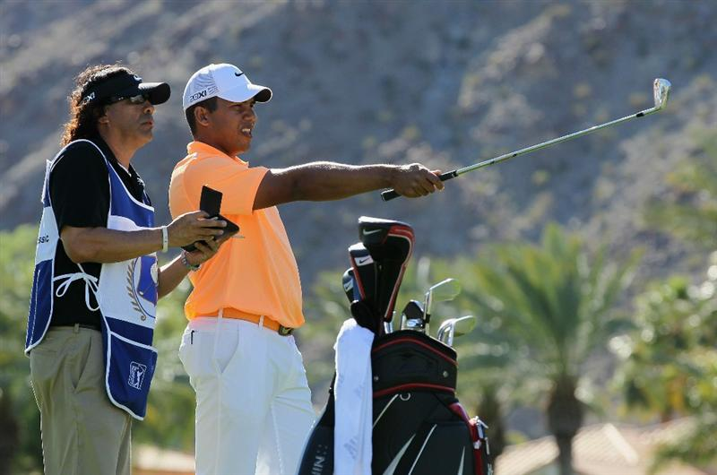 LA QUINTA, CA - JANUARY 23:  Jhonattan Vegas of Venezuela and his caddie discuss a tee shot on the fifth hole during the final round of the Bob Hope Classic at the Palmer Private course at PGA West on January 23, 2011 in La Quinta, California.  (Photo by Jeff Gross/Getty Images)