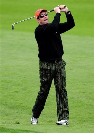 PEBBLE BEACH, CA - FEBRUARY 10:  Musician Huey Lewis plays a shot during the 3M Celebrity Challenge at the AT&T Pebble Beach National Pro-Am at Pebble Beach Golf Links on February 10, 2010 in Pebble Beach, California.  (Photo by Stuart Franklin/Getty Images)