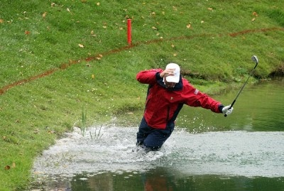 Woody Austin of the U.S. Team falls in the water after hitting a shot from the water on the 14th hole during the round two fourball matches at the Presidents Cup at The Royal Montreal Golf Club September 28, 2007 in Montreal, Quebec, Canada. PGA TOUR - 2007 The Presidents Cup - Second RoundPhoto by Scott Halleran/WireImage.com