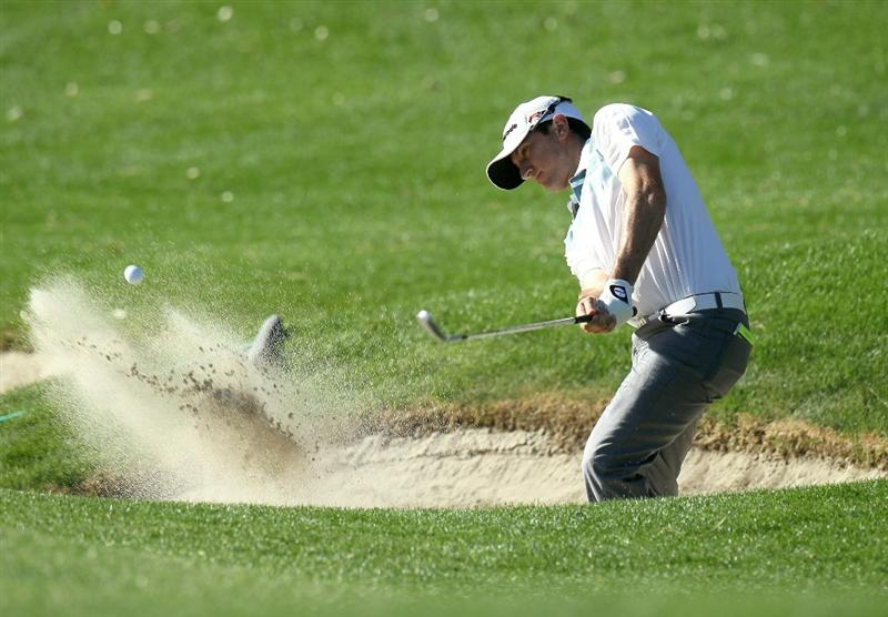 LA QUINTA, CA - JANUARY 20:  Peter Tomasulo hits out of a bunker shot on the 11th hole during round two of the Bob Hope Classic at the La Quinta Country Club on January 20, 2011 in La Quinta, California.  (Photo by Stephen Dunn/Getty Images)