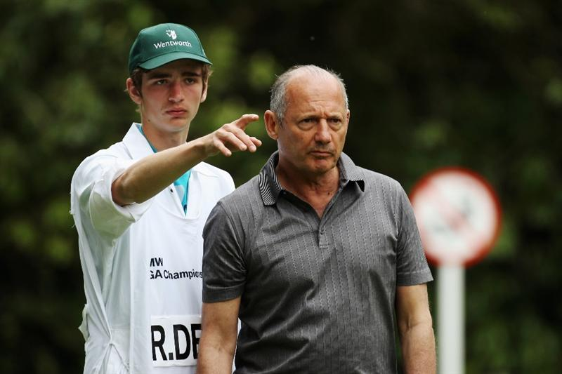 VIRGINIA WATER, ENGLAND - MAY 19:  Executive Chairman of McLaren Automotive Ron Dennis takes advice from his caddie during the Pro-Am round prior to the BMW PGA Championship on the West Course at Wentworth on May 19, 2010 in Virginia Water, England.  (Photo by Ross Kinnaird/Getty Images)