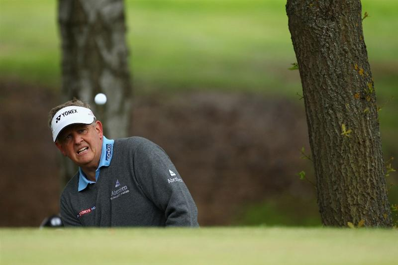 VIRGINIA WATER, ENGLAND - MAY 26:  Colin Montgomerie of Scotland chips onto the tenth green during the first round of the BMW PGA Championship at Wentworth Club on May 26, 2011 in Virginia Water, England.  (Photo by Richard Heathcote/Getty Images)