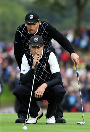 NEWPORT, WALES - OCTOBER 03:  Ross Fisher and Padraig Harrington of Europe line up a putt on the 17th green during the Fourball & Foursome Matches during the 2010 Ryder Cup at the Celtic Manor Resort on October 3, 2010 in Newport, Wales.  (Photo by Jamie Squire/Getty Images)