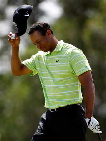 DORAL, FL - MARCH 14:  Tiger Woods reacts after holing out from a bunker on the 16th hole during the third round of the World Golf Championships-CA Championship on March 14, 2009 at the Doral Golf Resort and Spa in Doral, Florida.  (Photo by Jamie Squire/Getty Images)