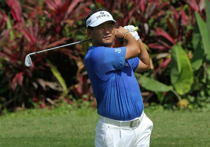 KUALA LUMPUR, MALAYSIA - OCTOBER 28: K.J. Choi of South Korea hits his 2nd shot on the 1st hole during day one of the CIMB Asia Pacific Classic at The MINES Resort & Golf Club on October 28, 2010 in Kuala Lumpur, Malaysia. (Photo by Stanley Chou/Getty Images)
