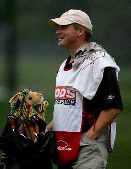 PALM HARBOR, FL - MARCH 06:  Head coach Jon Gruden of the Tampa Bay Buccaneers caddies for John Daly during the first round of the PODS Championship at Innisbrook Resort and Golf Club on March 6, 2008 in Palm Harbor, Florida.  (Photo by Sam Greenwood/Getty Images)