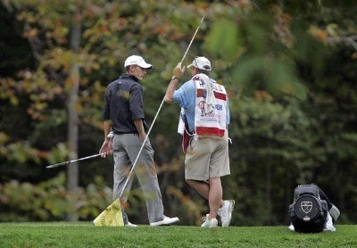 Charles Howell III speaks with his caddie on the 8th hole during the third round of the 84 LUMBER Classic held on the Mystic Rock Course at Nemacolin Woodlands Resort & Spa in Farmington, Pennsylvania, on September 16, 2006.Photo by Hunter Martin/WireImage.com
