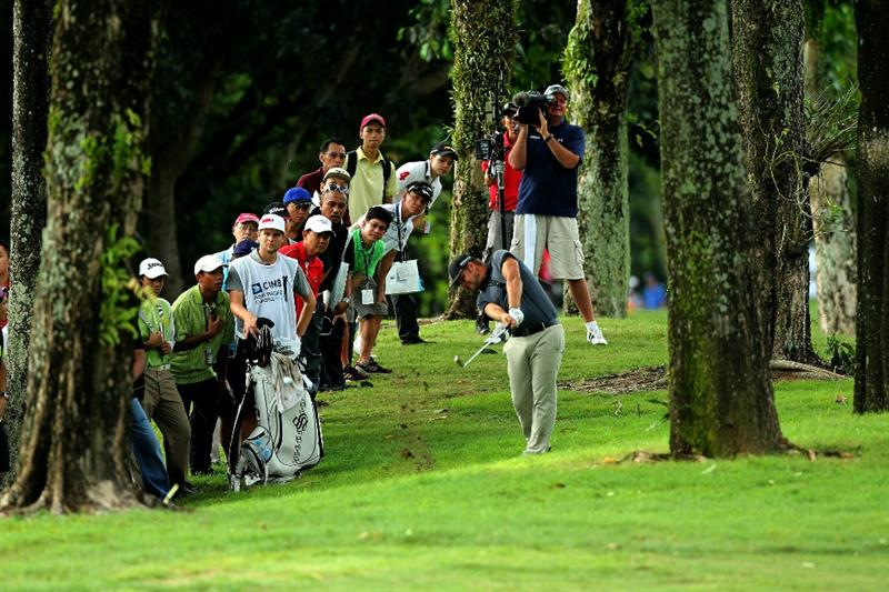 KUALA LUMPUR, MALAYSIA - OCTOBER 30: Ryan Moore of USA hits out of the rough on the 18th hole during day three of the CIMB Asia Pacific Classic at The MINES Resort & Golf Club on October 30, 2010 in Kuala Lumpur, Malaysia. (Photo by Stanley Chou/Getty Images)