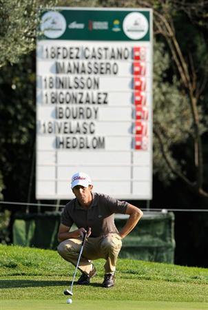 CASTELLON DE LA PLANA, SPAIN - OCTOBER 22:  Gregory Bourdy of France lines up his putt on the nineth hole during the second round of the Castello Masters Costa Azahar at the Club de Campo del Mediterraneo on October 22, 2010 in Castellon de la Plana, Spain.  (Photo by Stuart Franklin/Getty Images)
