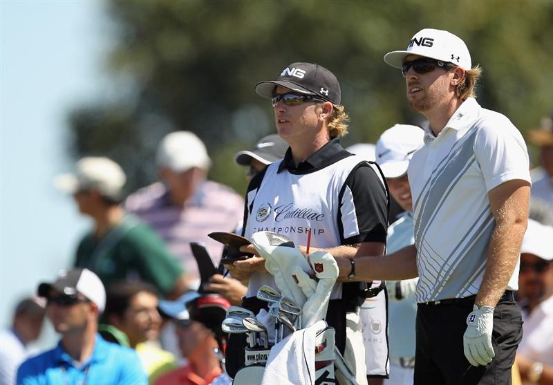 DORAL, FL - MARCH 13:  Hunter Mahan waits with his caddie John Wood on the second hole during the final round of the 2011 WGC- Cadillac Championship at the TPC Blue Monster at the Doral Golf Resort and Spa on March 13, 2011 in Doral, Florida.  (Photo by Mike Ehrmann/Getty Images)