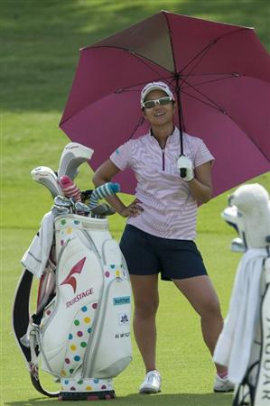 CHON BURI, THAILAND - FEBRUARY 19:  Ai Miyazato of Japan waits next to her golf bag on the 18th hole during day three of the LPGA Thailand at Siam Country Club on February 19, 2011 in Chon Buri, Thailand.  (Photo by Victor Fraile/Getty Images)