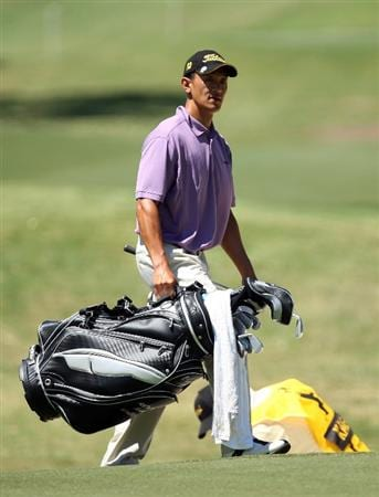 PERTH, AUSTRALIA - FEBRUARY 20:  Anthony Kang of USA carries his bag whilst his caddie rakes the bunker after his second shot at the 9th hole during the second round of the 2009 Johnnie Walker Classic tournament at the Vines Resort and Country Club on February 20, 2009, in Perth, Australia  (Photo by David Cannon/Getty Images)