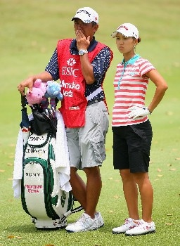 SINGAPORE - MARCH 02:  Momoko Ueda of Japan waits with her caddie on the ninth hole during the final round of the HSBC Women's Champions at Tanah Merah Country Club on March 2, 2008 in Singapore.  (Photo by Andrew Redington/Getty Images)