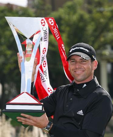 SHANGHAI, CHINA - NOVEMBER 10:  Sergio Garcia of Spain with the winners trophy after the final round of the HSBC Champions at Sheshan Golf Club on November 10, 2008 in Shanghai, China.  (Photo by Ross Kinnaird/Getty Images)