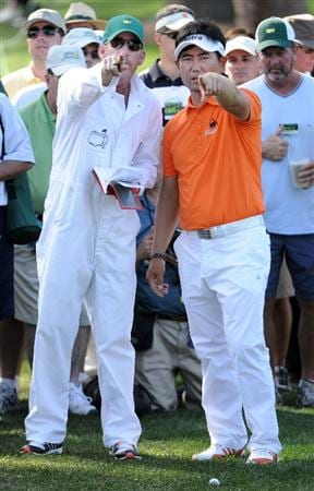 AUGUSTA, GA - APRIL 07:  Y.E. Yang of South Korea talks with his caddie Michael Bestor in the rough on the 17th hole during the first round of the 2011 Masters Tournament at Augusta National Golf Club on April 7, 2011 in Augusta, Georgia.  (Photo by Harry How/Getty Images)