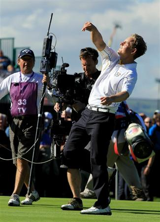 NEWPORT, WALES - OCTOBER 04:  Luke Donald of Europe throws his ball to the crowd after he won his match on the 18th green in the singles matches during the 2010 Ryder Cup at the Celtic Manor Resort on October 4, 2010 in Newport, Wales.  (Photo by David Cannon/Getty Images)