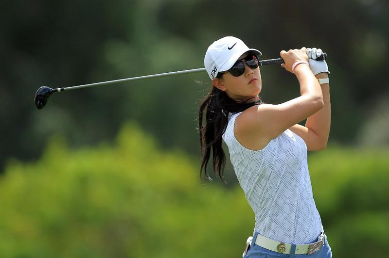 RANCHO MIRAGE, CA - APRIL 02:  Michelle Wie of the USA plays her tee shot at teh par 4, 6th hole during the third round of the 2011 Kraft Nabisco Championship on the Dinah Shore Championship Course at the Mission Hills Country Club on April 2, 2011 in Rancho Mirage, California.  (Photo by David Cannon/Getty Images)