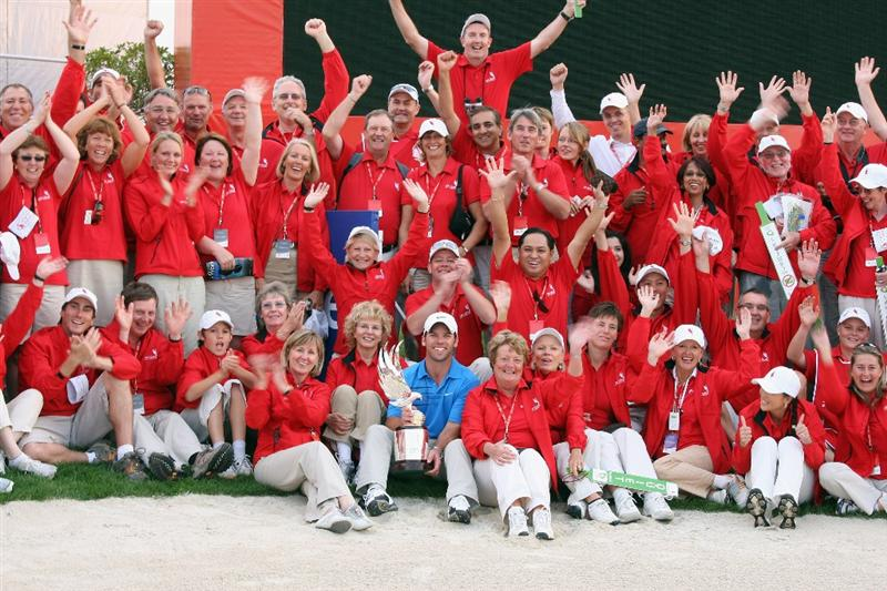 ABU DHABI, UNITED ARAB EMIRATES - JANUARY 18:  Paul Casey of England holds the trophy with the course marshalls after the final round of the Abu Dhabi Golf Championship held at the Abu Dhabi Golf Club on January 18, 2009 in Abu Dhabi, United Arab Emirates  (Photo by David Cannon/Getty Images)