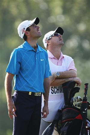 VIRGINIA WATER, ENGLAND - MAY 21:  Charles Schwartzel of South Africa and his caddie look at airplane flying overhead during the second round of the BMW PGA Championship on the West Course at Wentworth on May 21, 2010 in Virginia Water, England.  (Photo by Ross Kinnaird/Getty Images)