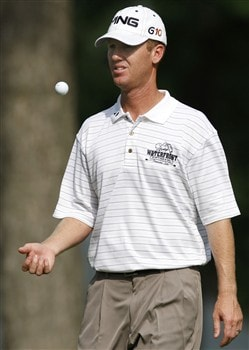 GRAND BLANC, MI - JUNE 26: Chris Riley tosses a ball while walking onto the 18th tee box during the first round of the Buick Open at Warwick Hills Golf and Country Club on June 26, 2008 in Grand Blanc, Michigan. (Photo by Gregory Shamus/Getty Images)