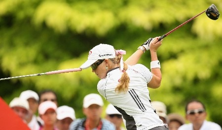 SINGAPORE - FEBRUARY 29:  Paula Creamer of the USA goes through a practice routine on the par four 6th hole during the second round of the HSBC Women's Champions at the Tanah Merah Country Club on February 29, 2008 in Singapore.  (Photo by Ross Kinnaird/Getty Images)