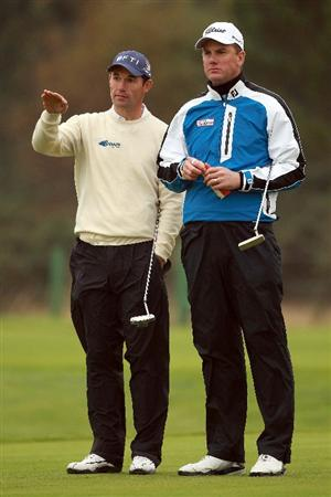 CARNOUSTIE, SCOTLAND - OCTOBER 09:  Padraig Harrington of Ireland and Robert Karlsson of Sweden on the 13th hole during the third round of The Alfred Dunhill Links Championship at the Carnoustie Golf Links on October 9, 2010 in Carnoustie, Scotland.  (Photo by Andrew Redington/Getty Images)