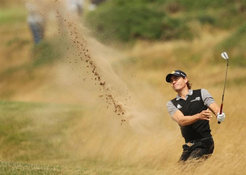 TURNBERRY, SCOTLAND - JULY 18:  Camilo Villegas of Colombia hits out of a bunker during round three of the 138th Open Championship on the Ailsa Course, Turnberry Golf Club on July 18, 2009 in Turnberry, Scotland.  (Photo by Ross Kinnaird/Getty Images)