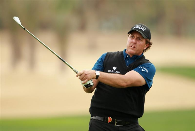ABU DHABI, UNITED ARAB EMIRATES - JANUARY 20:  Phil Mickelson of the USA hits his second shot on the ninth hole during the first round of The Abu Dhabi HSBC Golf Championship at Abu Dhabi Golf Club on January 20, 2011 in Abu Dhabi, United Arab Emirates.  (Photo by Andrew Redington/Getty Images)