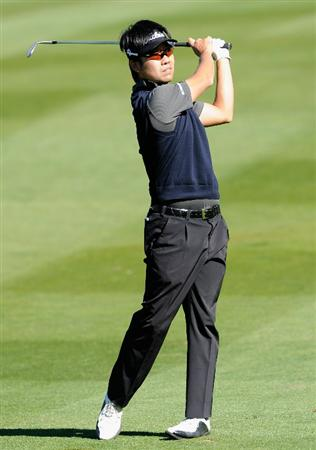 PEBBLE BEACH, CA - FEBRUARY 12:  Kevin Na plays his approach shot on the 17th hole during the third round of the AT&T Pebble Beach National Pro-Am at the Spyglass Hil Golf Course on February 11, 2011  in Pebble Beach, California  (Photo by Stuart Franklin/Getty Images)
