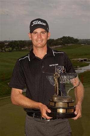 SAN ANTONIO, TX - APRIL 17: Brendan Steele poses with the champion's trophy after winning the Valero Texas Open at the AT&T Oaks Course at TPC San Antonio on April 17, 2011 in San Antonio, Texas. (Photo by Darren Carroll/Getty Images)