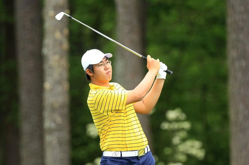 AUGUSTA, GA - APRIL 08:  Byeong-Hun An of South Korea hits his second shot on the 11th hole  during the first round of the 2010 Masters Tournament at Augusta National Golf Club on April 8, 2010 in Augusta, Georgia.  (Photo by David Cannon/Getty Images)