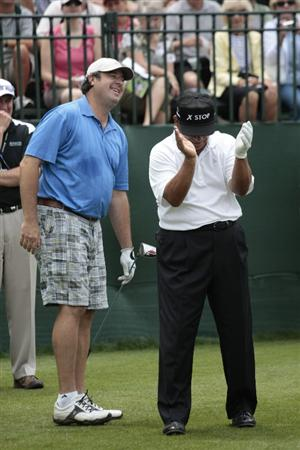 BIRMINGHAM, AL - MAY 14: Singer Vince Gill (L) laughs with Lee Trevino as they wait to tee off on the first hole during the Thursday Pro-AM of the Regions Charity Classic at the Robert Trent Jones Golf Trail at Ross Bridge on May 14, 2009  in Birmingham, Alabama. (Photo by Dave Martin/Getty Images)