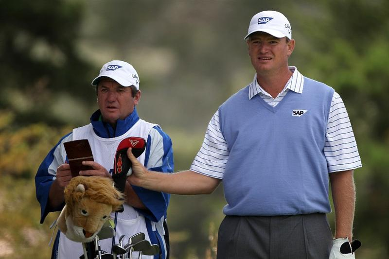 PEBBLE BEACH, CA - JUNE 19:  Ernie Els of South Africa waits with his caddie Ricci Roberts on the second tee during the third round of the 110th U.S. Open at Pebble Beach Golf Links on June 19, 2010 in Pebble Beach, California.  (Photo by Donald Miralle/Getty Images)