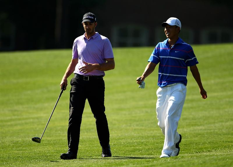 CHARLOTTE, NC - APRIL 30:  (L-R) Geoff Ogilvy and Anthony Kim walk down the 7th fairway during the second round of the Quail Hollow Championship at Quail Hollow Country Club on April 30, 2010 in Charlotte, North Carolina.  (Photo by Richard Heathcote/Getty Images)