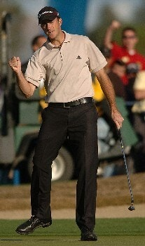 Geoff Ogilvy celebrates a par putt on the 10th green after winning a two hole play off in the final round of the PGA's Tour 2005 Chrysler Classic of Tucson at the Omni Tucson National Golf Resort & Spa February 27, 2005 in Tuscon, Arizona.