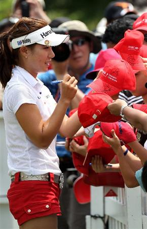 SINGAPORE - FEBRUARY 27:  Hee Young Park of South Korea signs autographs after the third round of the HSBC Women's Champions at the Tanah Merah Country Club on February 27, 2010 in Singapore.  (Photo by Ross Kinnaird/Getty Images)