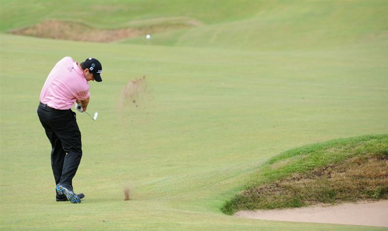 TURNBERRY, SCOTLAND - JULY 16:  Ben Curtis of USA hits an approach shot during round one of the 138th Open Championship on the Ailsa Course, Turnberry Golf Club on July 16, 2009 in Turnberry, Scotland.  (Photo by Harry How/Getty Images)