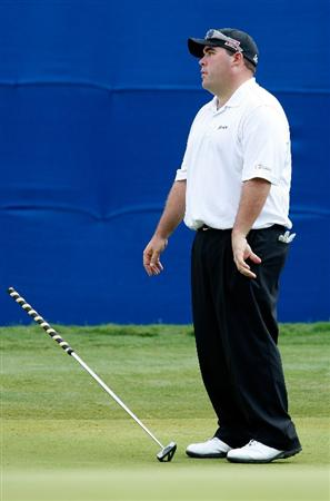 GREENSBORO, NC - AUGUST 23:  Kevin Stadler reacts to missing a putt on the 18th hole during the final round of the Wyndham Championship at Sedgefield Country Club on August 23, 2009 in Greensboro, North Carolina.  (Photo by Streeter Lecka/Getty Images)