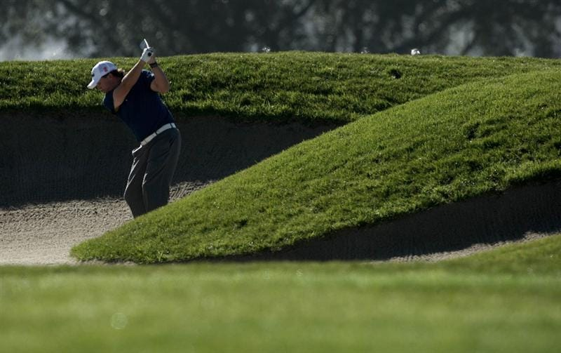 LA JOLLA, CA - JANUARY 28:  Phil Mickelson hits out of the 5th fairway bunker during the 2010 Farmers Insurance Open, Round 1 on January 28, 2010 at Torrey Pines in La Jolla, California. (Photo by Donald Miralle/Getty Images)