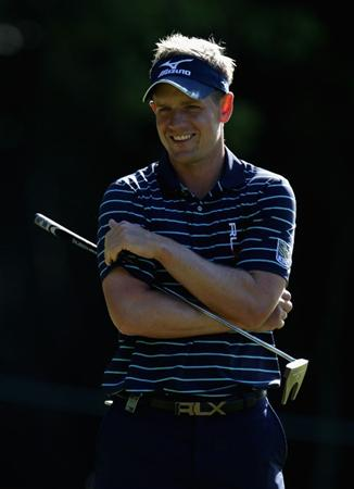 VIRGINIA WATER, ENGLAND - MAY 25:  Luke Donald of England looks on during the Pro-Am round prior to the BMW PGA Championship at Wentworth Club on May 25, 2011 in Virginia Water, England.  (Photo by Ross Kinnaird/Getty Images)