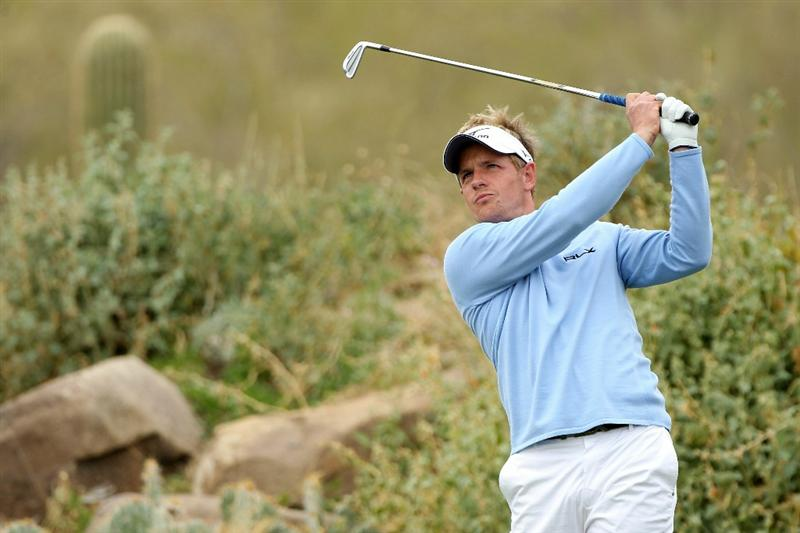 MARANA, AZ - FEBRUARY 26:  Luke Donald of England hits his tee shot on the 12th hole during the semifinal round of the Accenture Match Play Championship at the Ritz-Carlton Golf Club on February 26, 2011 in Marana, Arizona.  (Photo by Andy Lyons/Getty Images)