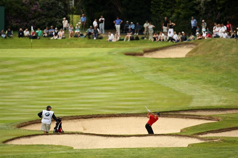 WENTWORTH, ENGLAND - MAY 23:  Charl Schwartzel of South Africa hits his second shot on the 4th hole during the Third Round of the BMW PGA Championship at Wentworth on May 23, 2009 in Virginia Water, England.  (Photo by Ross Kinnaird/Getty Images)
