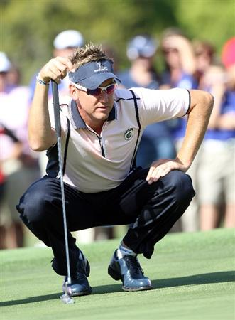 ORLANDO, FL - MARCH 14:  Ian Poulter of England looks over a putt on the 16th hole during the first day of the Tavistock Cup at Isleworth Golf and Country Club on March 14, 2011 in Orlando, Florida.  (Photo by Sam Greenwood/Getty Images)