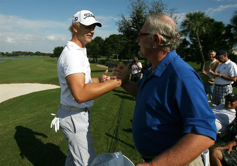 WEST PALM BEACH, FL - DECEMBER 07:  David Lutterus of Australia celebrates with a friend after qualifying for the 2010 PGA TOOR by finishing tied for eighth place during the final round of the 2009 PGA TOUR Qualifying Tournament at Bear Lakes Country Club on December 7, 2009 in West Palm Beach, Florida.  (Photo by Doug Benc/Getty Images)